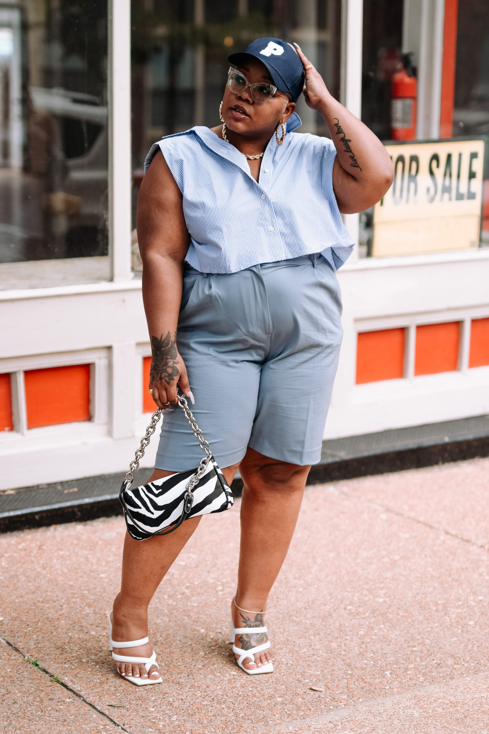 black plus size fashion and style influencer wearing dress bermuda shorts and a padded button up crop shirt from H&M on Cherokee St in St. Louis, MO
