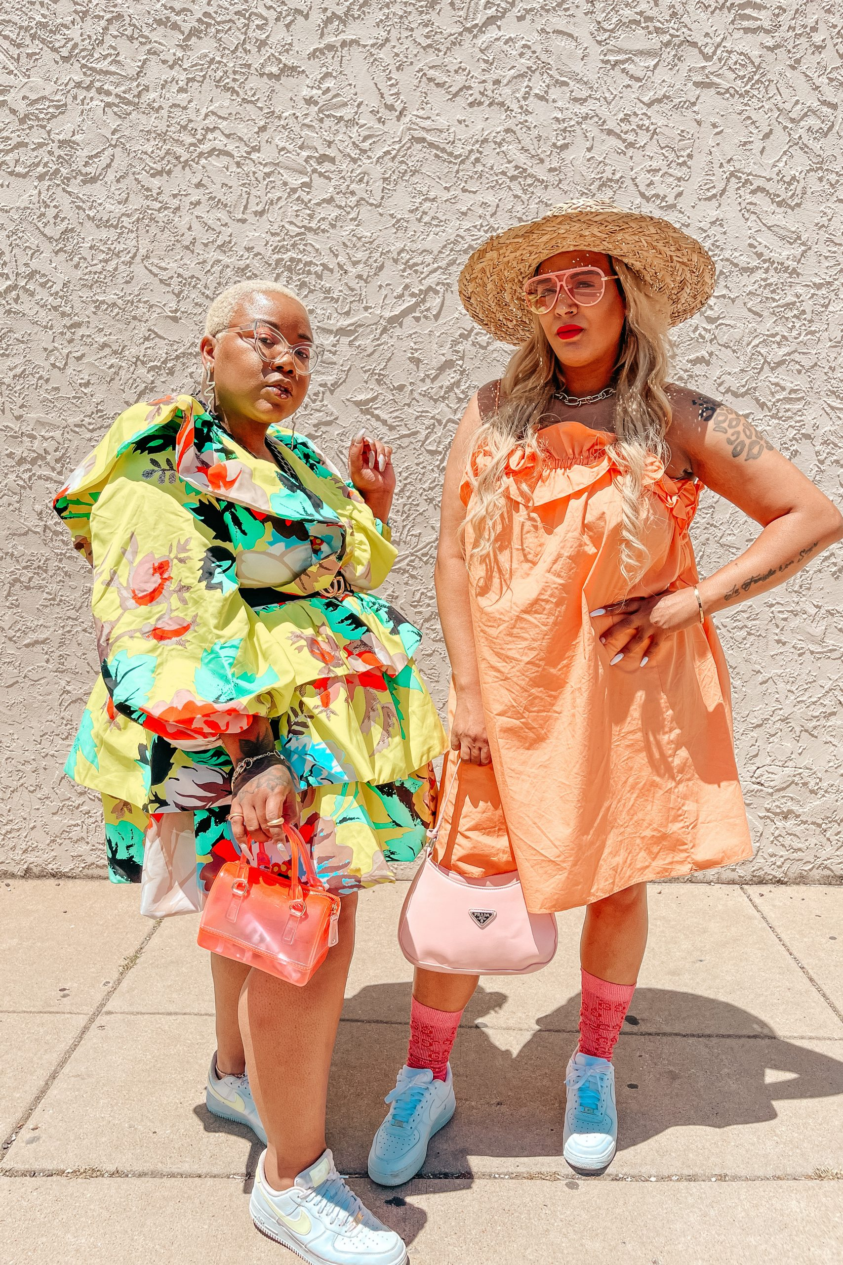 AK Brown & Courtney McManemy of The Fashion Besties wearing Christopher Rogers Neon 2 Dress from Target and Gucci Belt and a ruffled trimmed dress from H&M and Prada bag in St. Louis MO